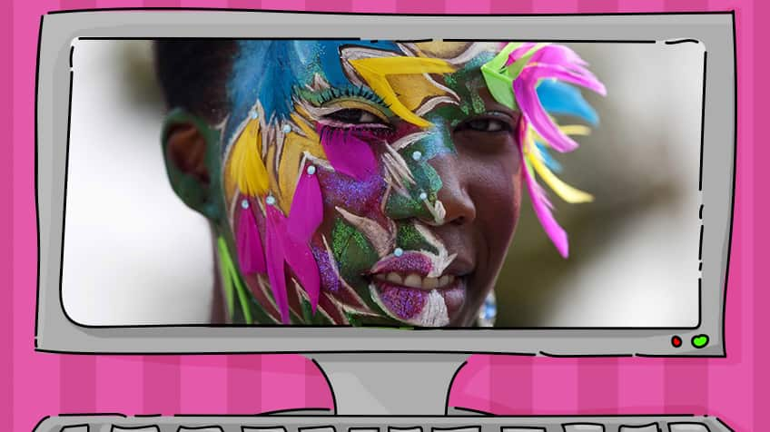 Black woman models beautiful face paint with feathers and lashes