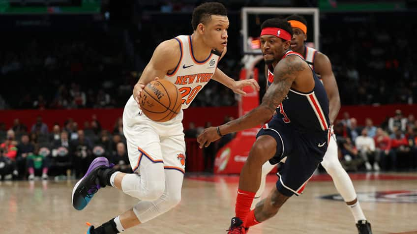 Kevin Knox II #20 of New York Knicks dribbles past Bradley Beal #3 of the Washington Wizards.