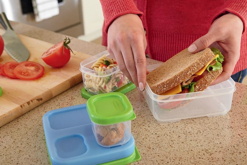 Someone packing a lunch in reusable containers