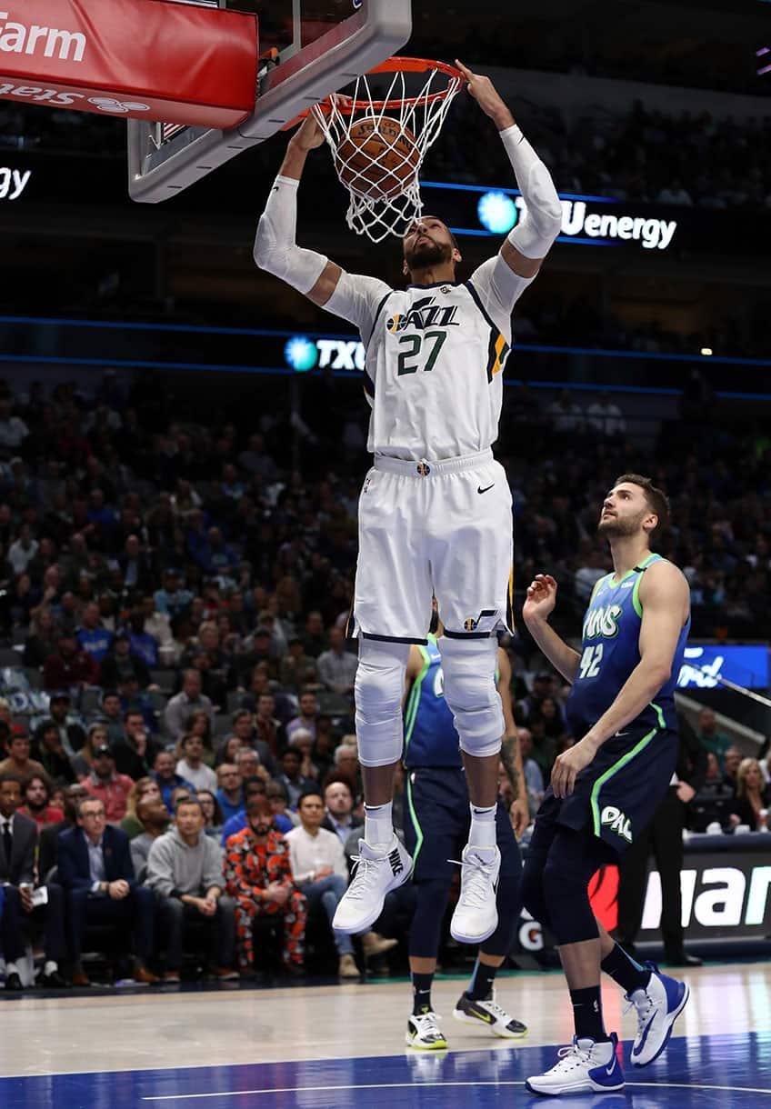 Rudy Gobert #27 of the Utah Jazz makes an alley-oop dunk against the Dallas Mavericks.