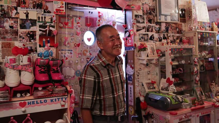 Masao Gunji stands in his room full of Hello Kitty memorabilia.