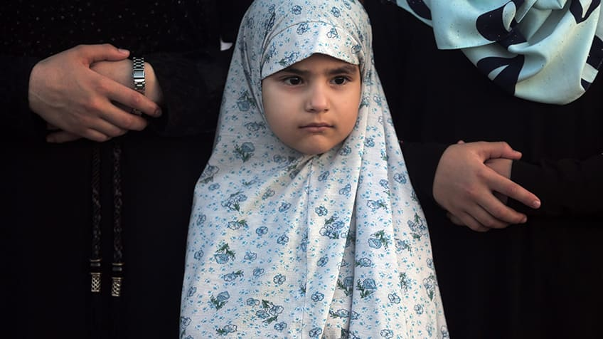 Close-up of a young Muslim girl .