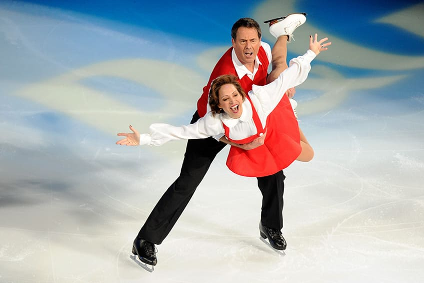 Peter lift Kitty Carruthers as they perform on the ice during Tribute to American Legends of the Ice