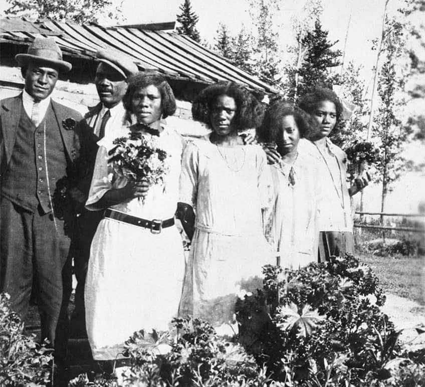 historical photo of Thomas Mapp and his family standing in front of their Alberta homestead