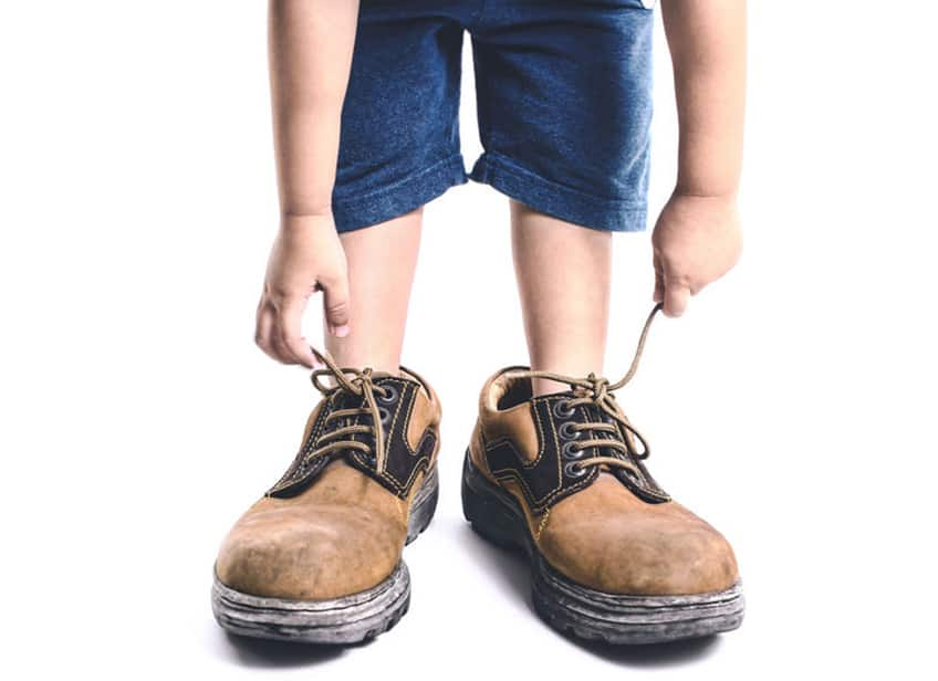 little kid with big shoes