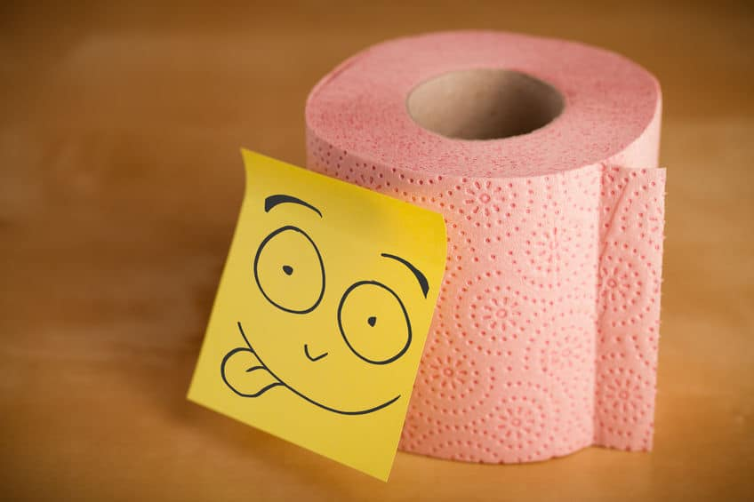 roll of toilet paper with post it note that has funny face on it