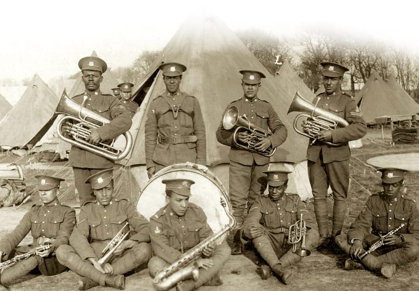 men in the band with their instruments of trumpets, tubas and a drum