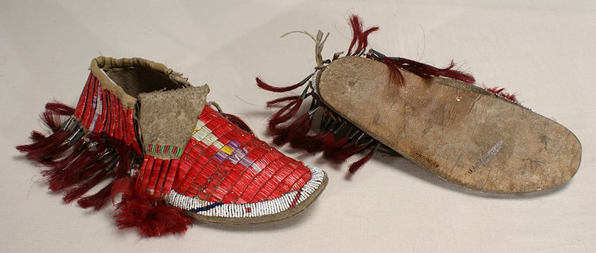 moccasins with decorative beads and porcupine quills along the side