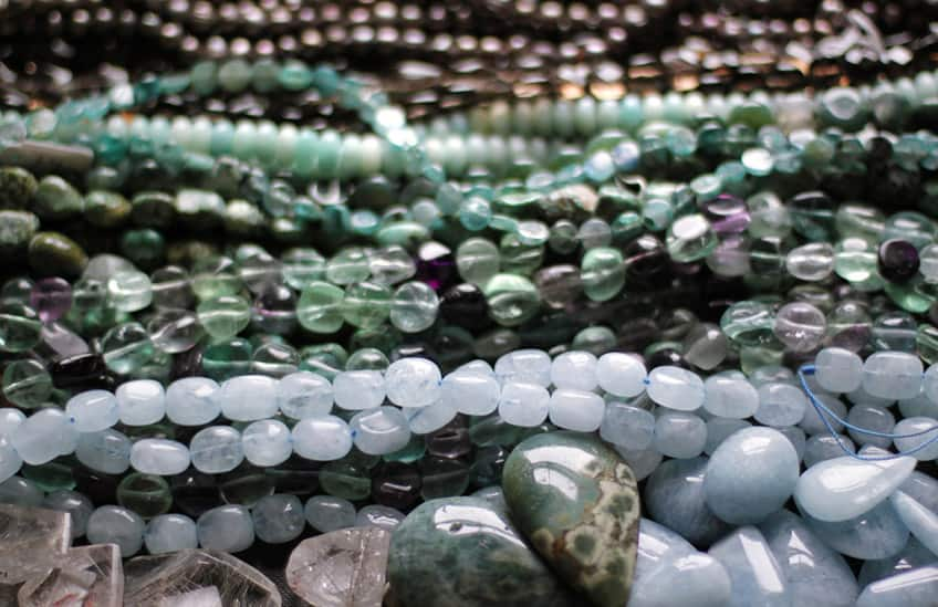 piles of different strings of stone beads