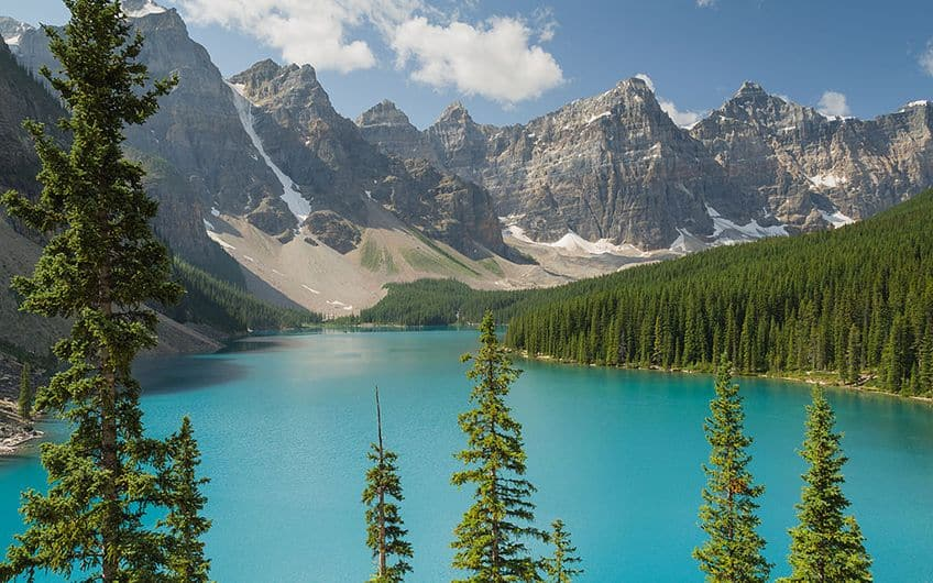 a view of the blue waters of Moraine Lake in Alberta