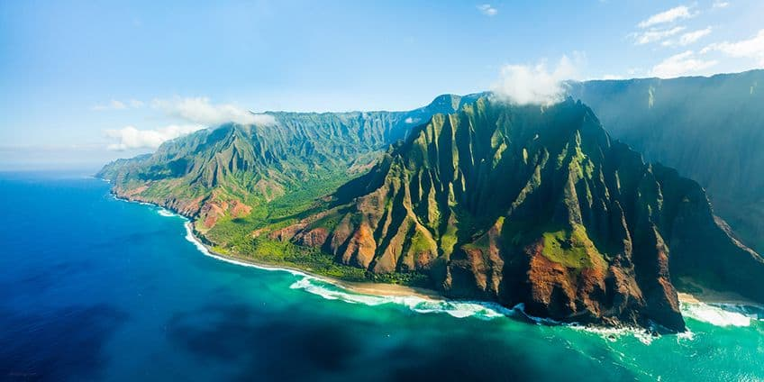 coastal mountains leading into blue waters in Hawaii