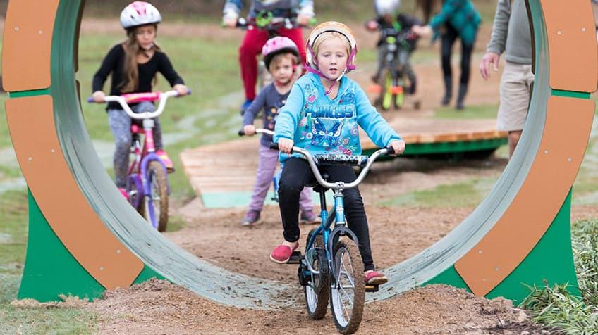 Children on their bikes at the Bentonville Bicycle Playground.