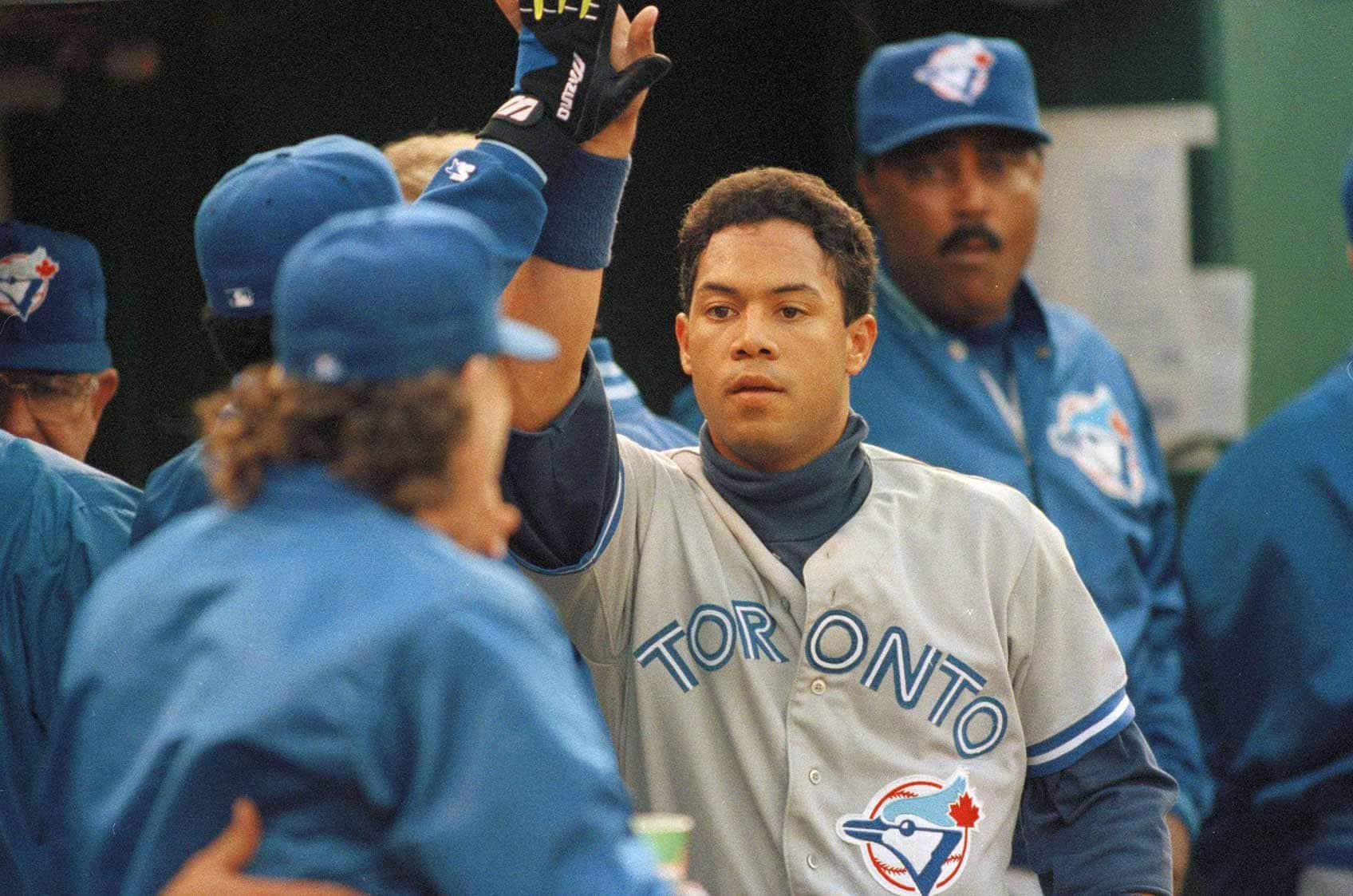 Toronto Blue Jays second baseman Roberto Alomar is congratulated by teammates after hitting a homrerun against the Oakland A's, at the Oakland Coliseum, May 5, 1992.