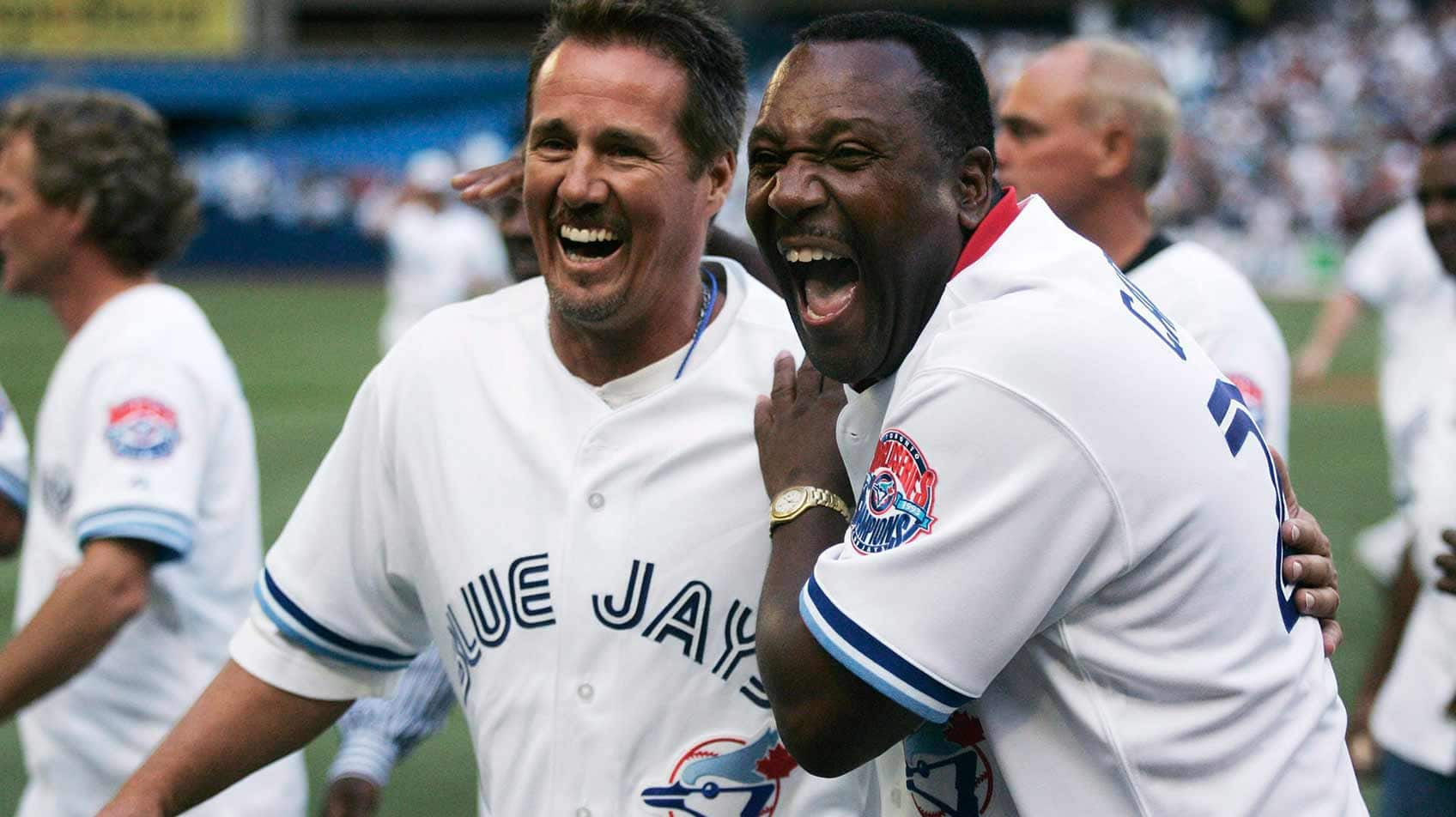 Pat Boarders, left, and Joe Carter share a laugh as they walk off the field after the Toronto Blue Jays World Series team from 1992 and 1993 were celebrated at Rogers Centre