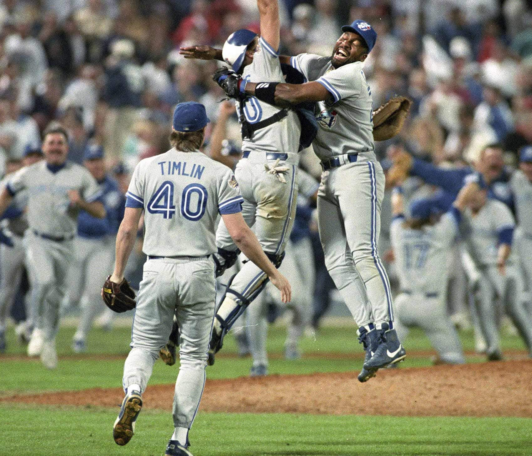 Toronto Blue Jays Joe Carter (right) and Pat Borders leap into the air as pitcher Mike Timlin (left) looks on as the Toronto Blue Jays downed the Atlanta Braves to win the 1992 World Series in Atlanta Oct. 24, 1992.