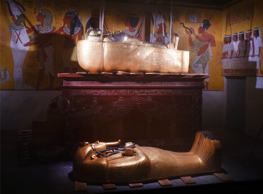 A replica of King Tut's tomb with hieroglyphs and the pharaoh's impressive gold coffins