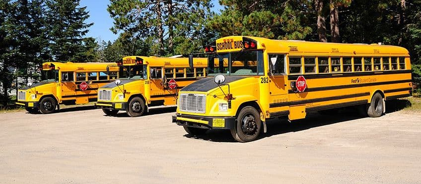 three school buses in a row