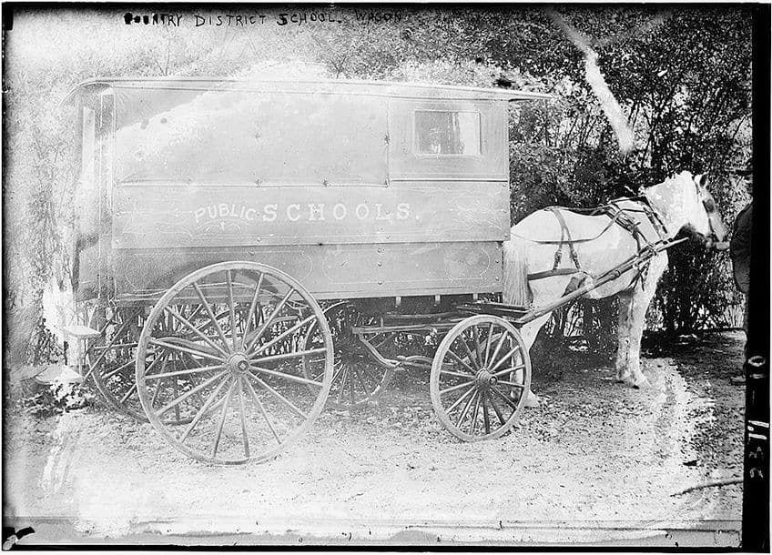 photo of an original school bus pulled by a horse