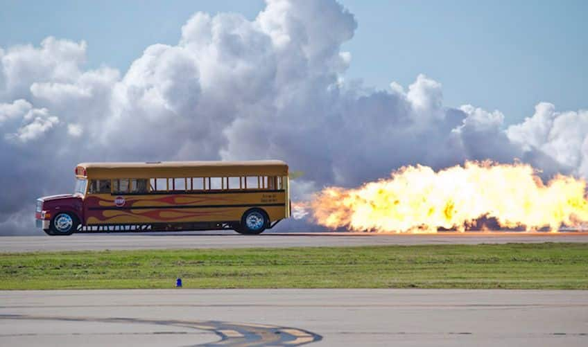 a jet-propelled bus with flames shooting out from the back