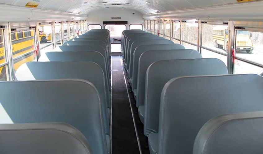 two rows of tall seats in a school bus