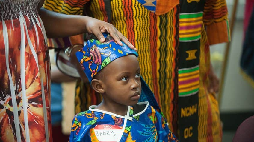 Child dressed in traditional African clothing.