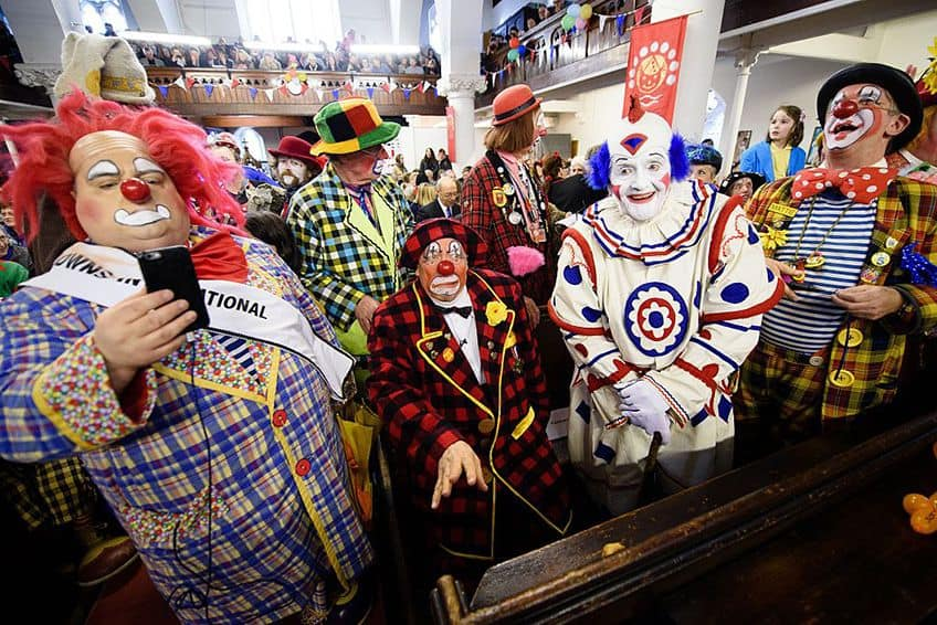 Dozens of costumed clowns gather at the Holy Trinity church for the annual church service,