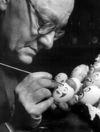 historical photo showing Stan Bult painting the original eggs in the collection