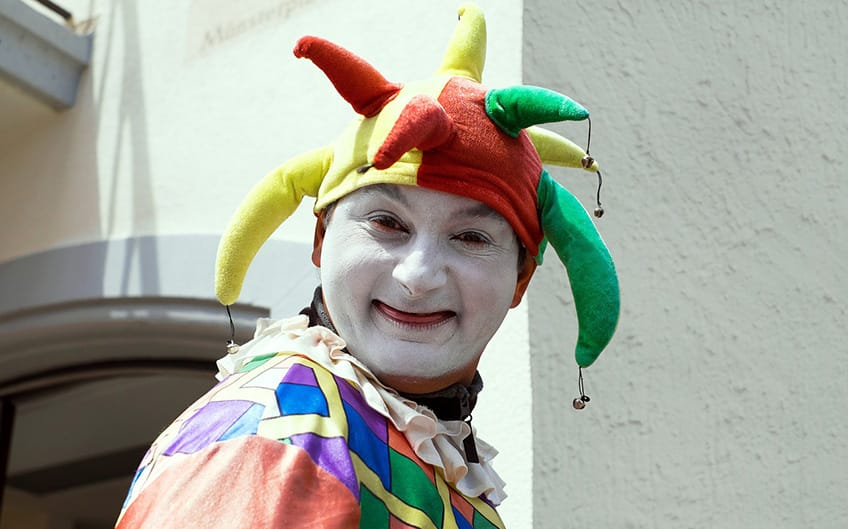clown dressed up as a court jester