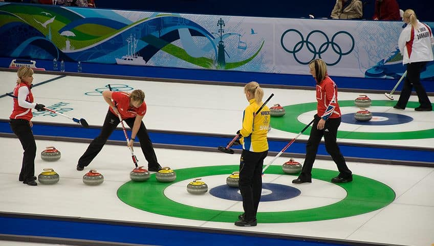 women's curling team on the ice