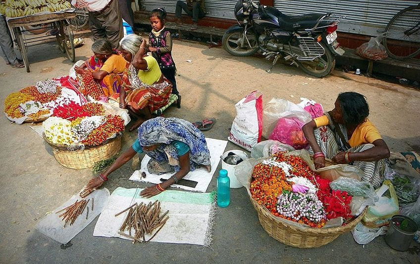 street scene in India with women selling goods on blankets