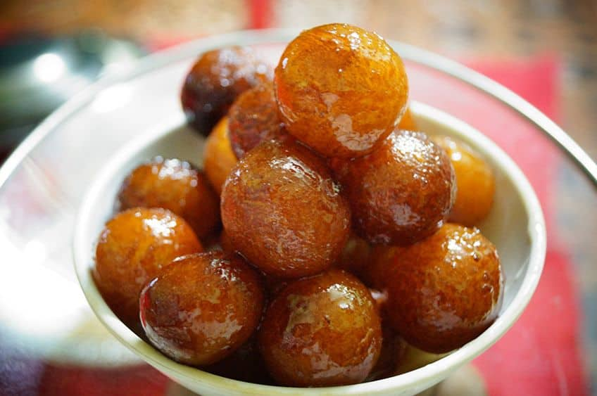 balls of gulab jumun loaded on a plate