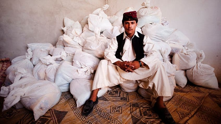 Man poses with donations for the poor.