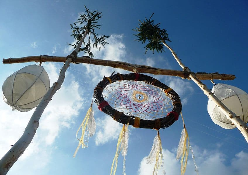 dream catcher hanging off trees