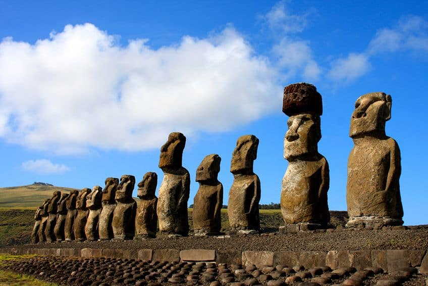 a row of 15 stone heads