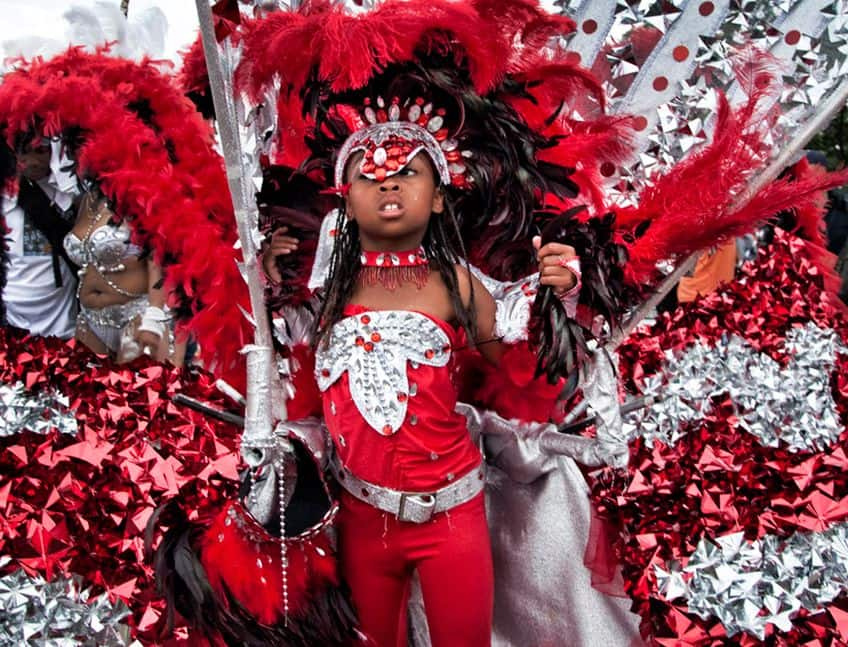 a young boy in red regalia at the Toronto Caribana festival