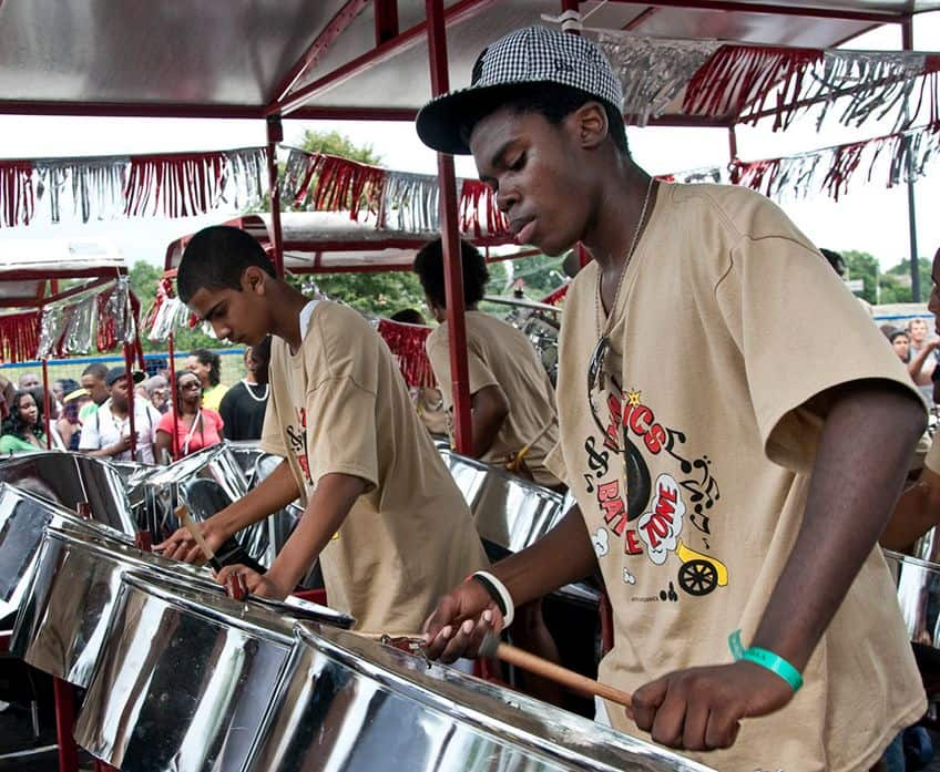 young men playing traditional steel drums