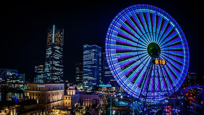 ferris wheel lit up with a big clock