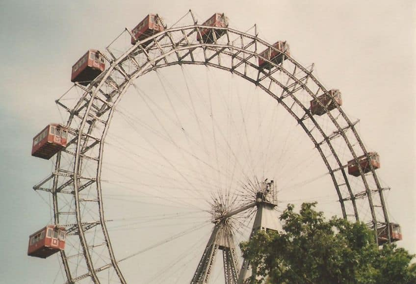 old ferris wheel with wood cabins