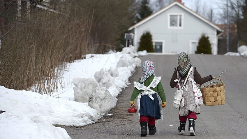 Kids dress up to go door-to-door to give out pussy willows in exchange for candy.