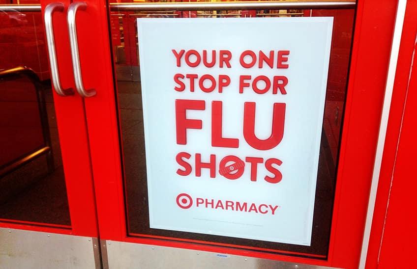 flu shots sign at a pharmacy