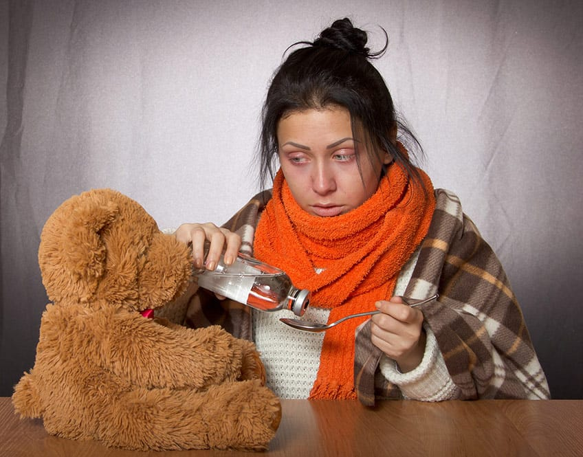 girl who is sick with teddy bear