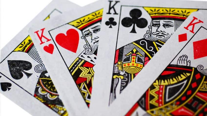 A set of Kings splayed showing all four suits.