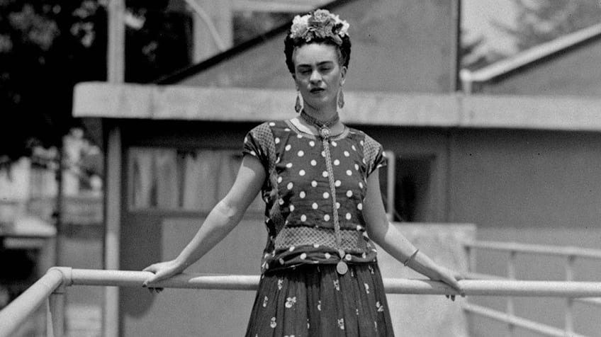 Freida Kahlo poses outside
