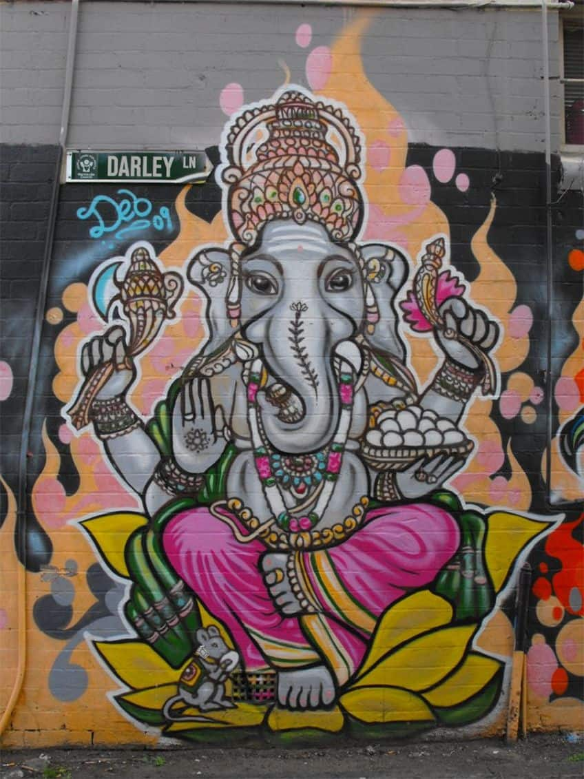 Colourful Ganesh graffiti art, with his mouse.
