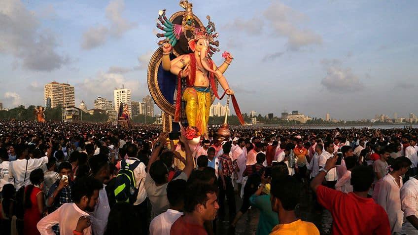 Crowds gather around giant idol of Ganesh during the festival of Ganesh Chaturthi.