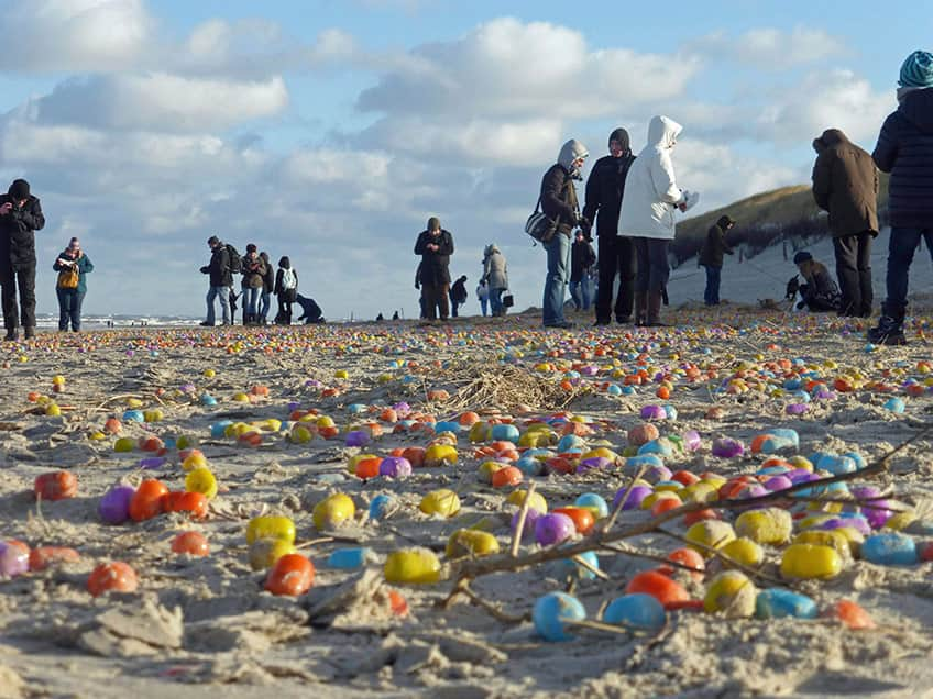 plastic eggs washed ashore on the beach of the island of Langeoog