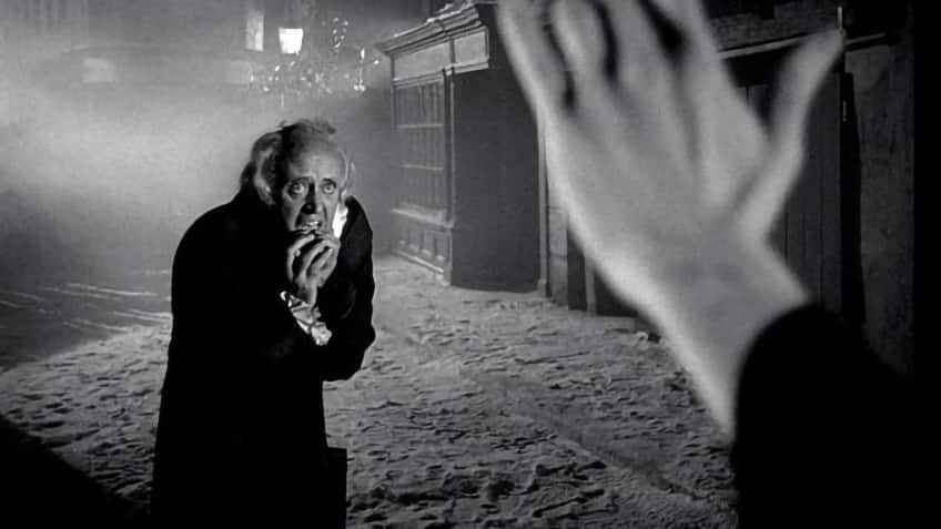 film still from Scrooge with Alastair Sim cowering before the hand of death