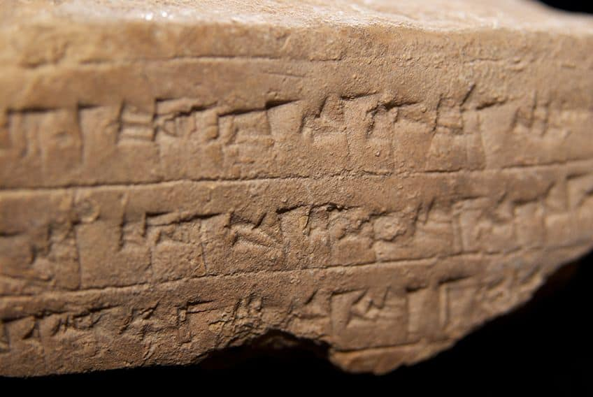 a clay tablet showing Cuneiform characters