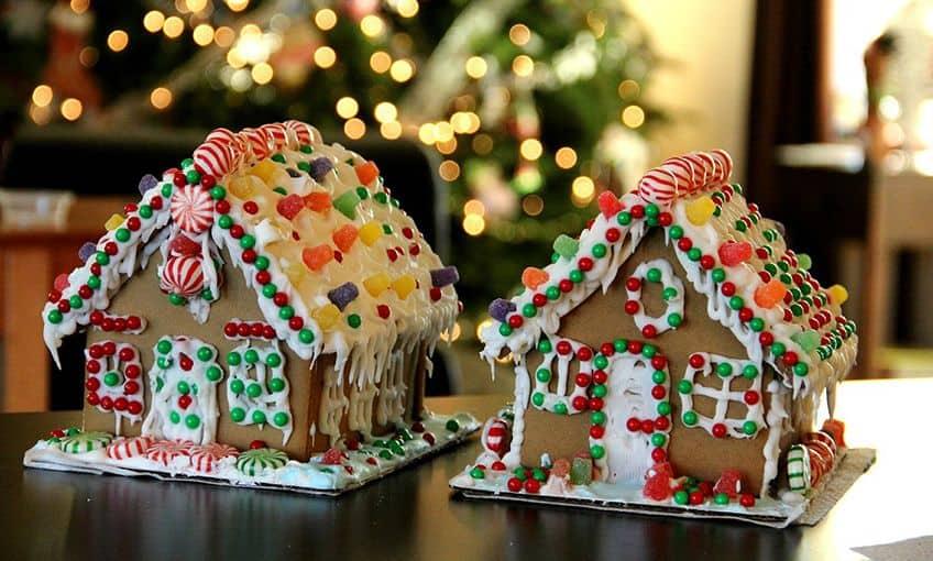 gingerbread houses near a Christmas tree