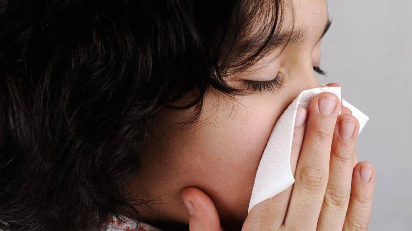 Girl blows nose.